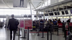 Man walking in suit with bag - people checking in waiting in line JFK airport 4K Stock Footage
