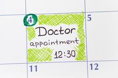 Reminder Doctor appointment in calendar Stock Photos