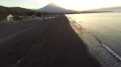 Sunset in Amed on the beach with view of Agung volcano, aerial shot Stock Footage