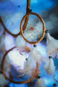 Dreamcatcher against a white blur of snow Stock Photos