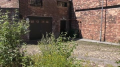 Old industrial buildings pan up blue sky potteries bottle kiln. Stock Footage