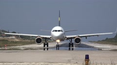 Aircraft front view on airport runway Stock Footage