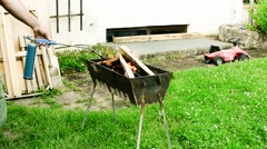 Firing a grill with a gas torch Stock Footage