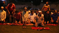 People pray after coup attempt. Stock Footage