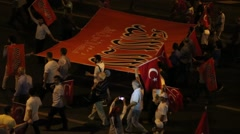 Walking people with banners and Turkish flags on the road Stock Footage