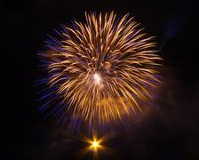 Isolated golden blue fireworks burst - stock photo