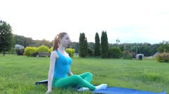 Sporty Girl Does Exercises in the Park. Stock Footage