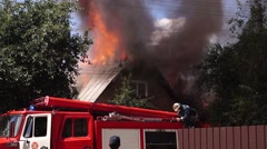 Firefighters at Work. Fire Truck Trying to Extinguish the Fire. Stock Footage
