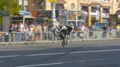 Trick rider demonstrate public wheelies on the rear wheel Stock Footage