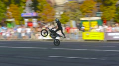 Professional rider shows a trick stand-up wheelie Stock Footage