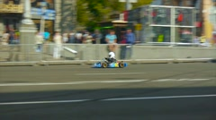Member of karting competitions rides on the highway in the city Stock Footage