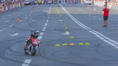 A child in a professional equipment overcomes the obstacle on a motorcycle Stock Footage
