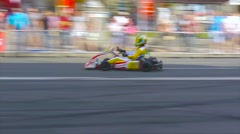 Kart driver is wagging on the track and makes a sharp turn Stock Footage