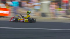 Kart driver approaching the finish line, race kart on city streets Stock Footage