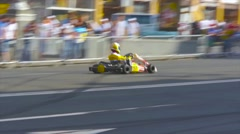 Kart drifting, karting driver demonstrates fast driving viewers Stock Footage