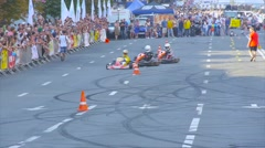 Kart drivers go close to each other, circling with warning cones Stock Footage