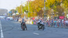Race two motorcyclists start, rear view Stock Footage