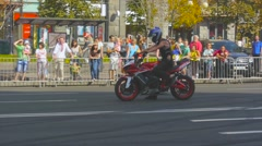 Rider shows a trick wheelies, riding on the rear wheel Stock Footage
