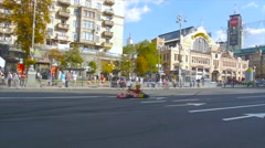 Kart driver is preparing to launch on a city street, championship Stock Footage