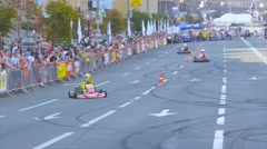 Competition karting on the street road, kart drivers show extreme driving Stock Footage