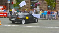 Black car racing unfolds without hooking road cones, car show, slow motion Stock Footage