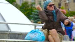 Intoxicated woman gesturing over her hands and talking to herself.homeless Stock Footage