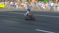 A child with a helmet on his head goes on a motorcycle Stock Footage
