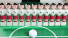 Toy football players stand in a row Stock Footage