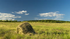 Hay harvesting stack hay farmers are preparing to float on clouds field Stock Footage