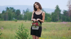 Beautiful girl in the black short dress on the green field - stock footage