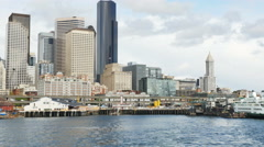 Looking aft from ferry departing Seattle toward the dock and the cit Stock Footage