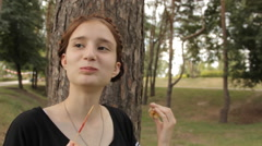 Hipster girl eats candy apple and laughs. Stock Footage