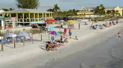 Ft Myers Beach Florida beach at famous pier with tourists sand Gulf of Mexico Stock Footage