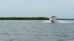 Bonita Springs Florida intercoastal waters with boat near mangroves in bay st Stock Footage