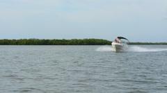 Bonita Springs Florida intercoastal waters with boat near mangroves in bay st Stock Footage