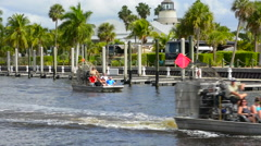 Everglades City Florida airboat with tourists riding on water in downtown cen Stock Footage