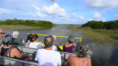 Everglades City Florida airboat ride fast with tourists riding on water  Stock Footage