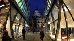 Commuters & shoppers walking through shopping arcade with St Pauls, London, UK Arkistovideo
