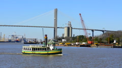 Savannah Georgia riverboat ride and the Talmadge Memorial Bridge with tourist Stock Footage