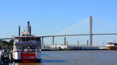 Savannah Georgia river and the Talmadge Memorial Bridge with tourist boat on  Stock Footage