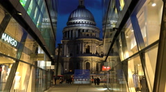 Commuters & shoppers walking through shopping arcade with St Pauls, London, UK Stock Footage