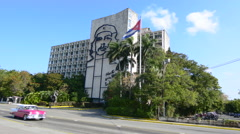 Hava Cuba Haba traffic and old cars with traffic at Che government building Stock Footage