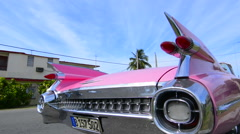 Varadero Beach Cuba famous pink 1959 big pink Cadilllac with fins and abstracts Stock Footage