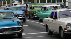 Hava Cuba traffic of old Classic autos on main street at Capital with old Stock Footage