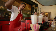 Hava Cuba bartenders mixing drinks at the Floridita bar Hemingways favorite Stock Footage
