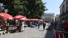 Old Hava Cuba Haba book stands in Plaza de Armas for tourists walking colorful Stock Footage