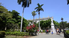 Old Hava Cuba Haba  Plaza de Armas with statues and tourists walking colorful Stock Footage
