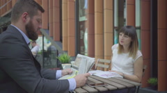 Businesspeople have coffe break during work. Outdoor. Steadicam. Stock Footage
