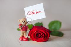 Toy teddy bear with a note  love and red rose Stock Photos