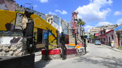 Hava Cuba famous Hamel Street for art andc artists in wild galleries and color Stock Footage